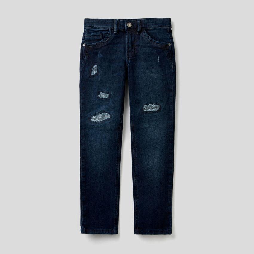Jeans slim fit con aspetto vissuto