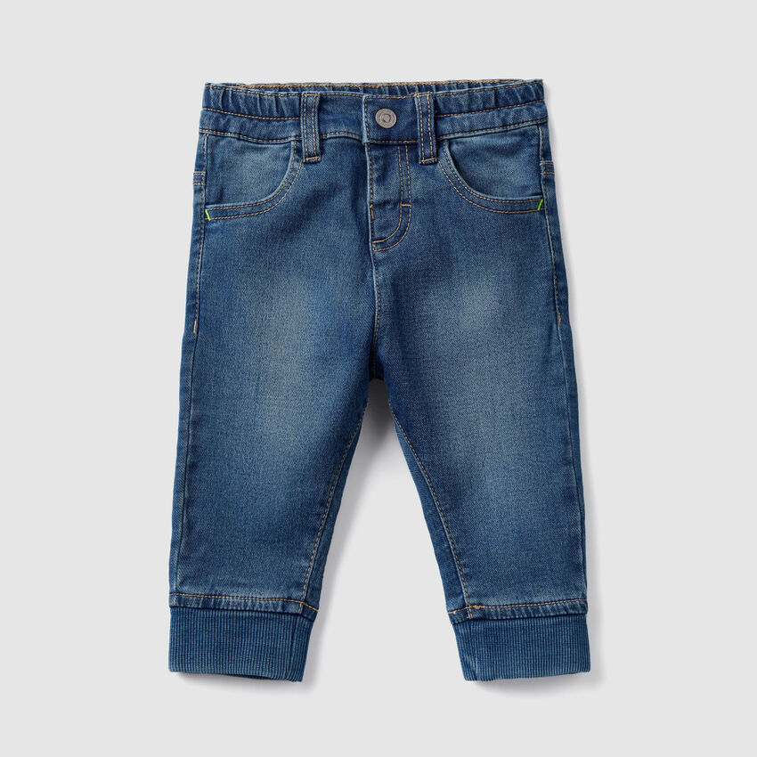 Jeans con cavigliere a costine