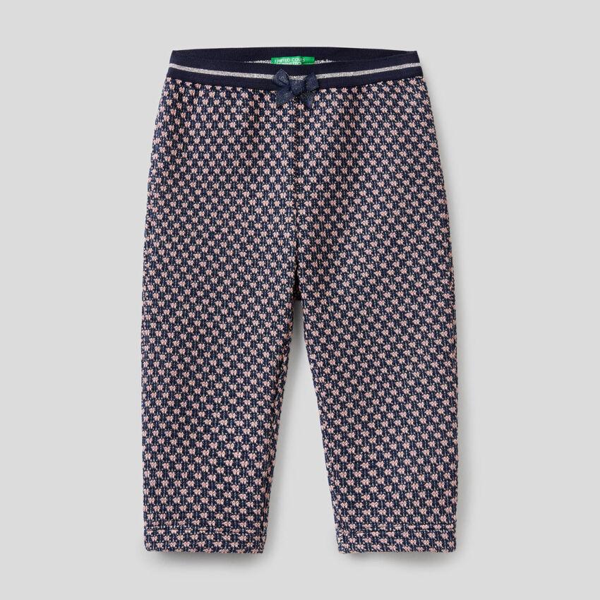Pantaloni con motivo geometrico bicolor