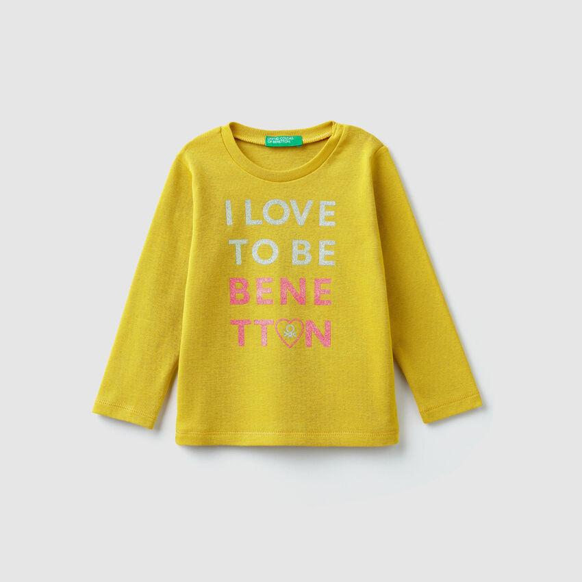 T-shirt a costine con logo glitter