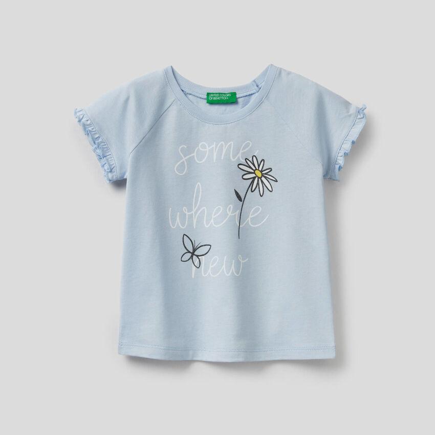 T-shirt con rouches e glitter
