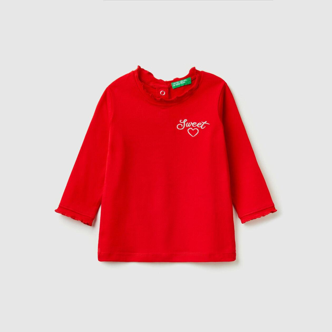 T-shirt con rouches e ricamo