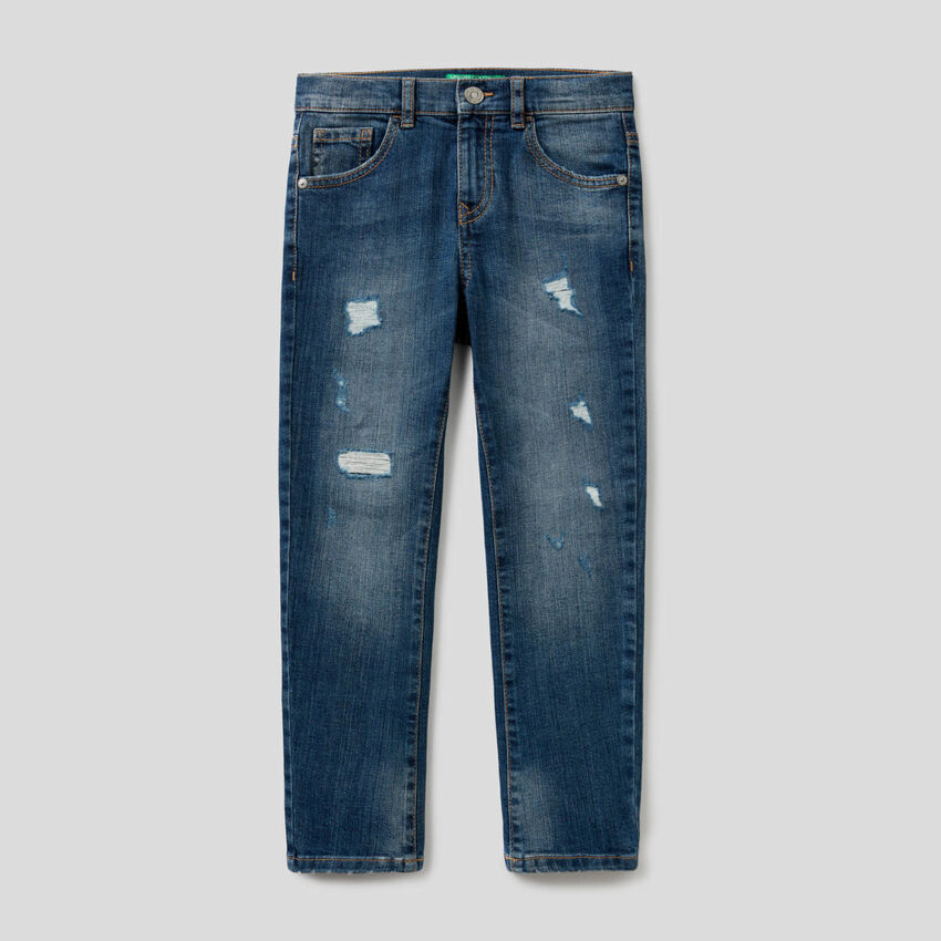Jeans skinny fit con rotture