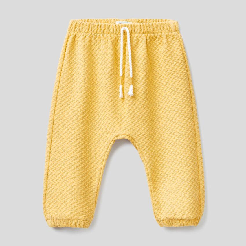 Pantaloni in cotone bio stretch lavorato