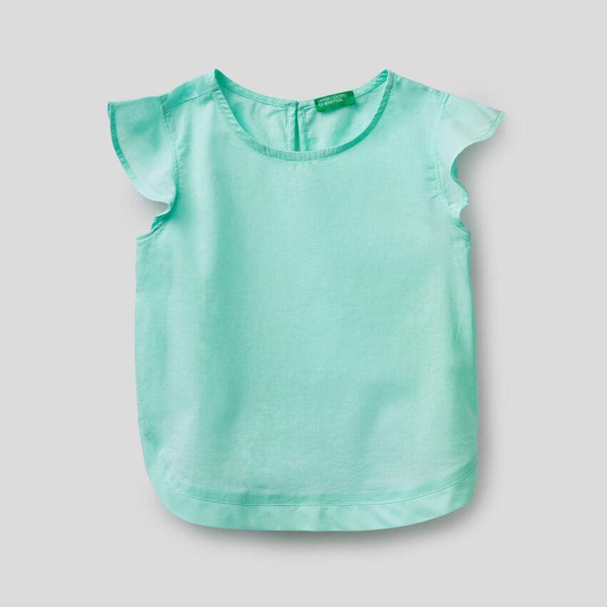 Blusa in cotone con manica volant