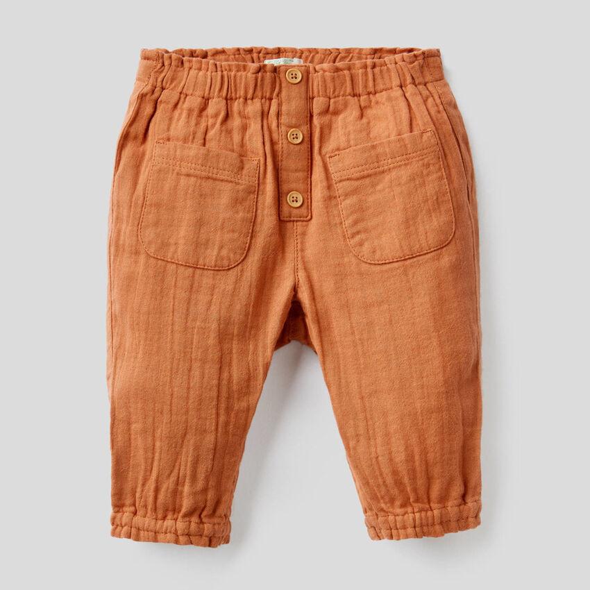 Pantaloni con vita e fondo arricciati