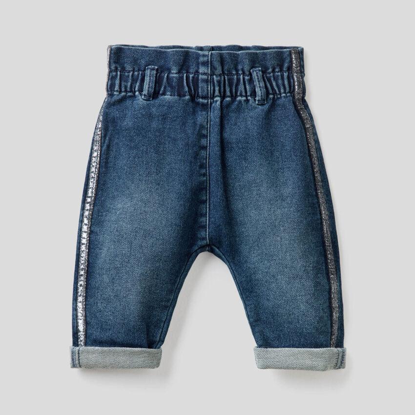 Jeans paperbag con banda in lurex